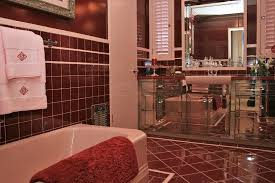 burgundy and pink 60s bathroom with mirrored vanity pink