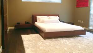 cool floating bed frame with night stand and mattress