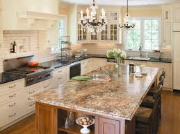 kitchen granite countertops and chandelier with kitchen hood plus