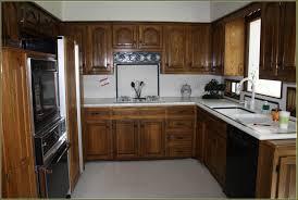 annie sloan chalk paint in old white wood kitchen cabinet update