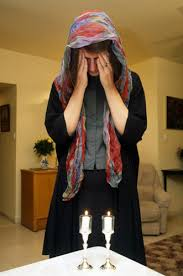 sabbath candles jerusalem a woman lighting sabbath candles at home