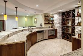 Pictures Of Finished Basements With Bars by Curved Bar Topped With Granite Slab Creates A Large Area For