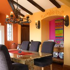 rust colored walls dining room southwestern with orange walls