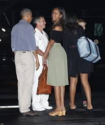 president obama and first family arrive in hawaii for christmas