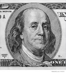 finance and currency detail of portrait on one hundred dollar bill