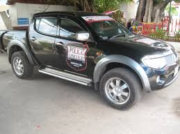mitsubishi cars logo file a car with police united fc logo in thailand by the border