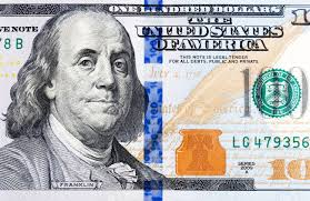 macro of a brand one hundred dollar bill showing the