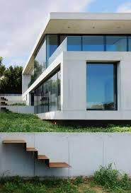 marvelous house featuring concrete exterior and glass covering by