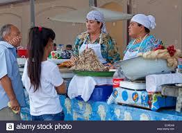 no rin women selling naryn norin uzbek pasta dish of fresh hand rolled
