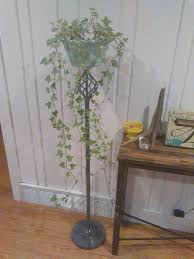 repurpose an old standing floor lamp into a plant stand hometalk