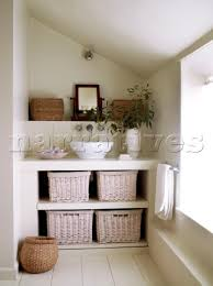 built in unit with countertop wash basin and storage baskets in