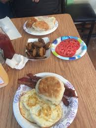 biscuit bacon eggs tomato slices home fries and biscuits and