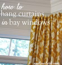 How To Hang Curtains On A Bay Window Hanging Curtains On Angled Windows Emily A Clark