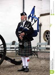 scottish bagpiper playing editorial stock image image 32964829
