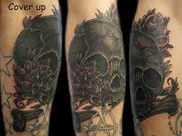 black and grey skull bone and flowers tattoo cover up a photo