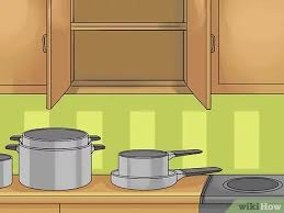 how to organize pots and pans in a cupboard how to organize the pots and pans cabinet 11 steps