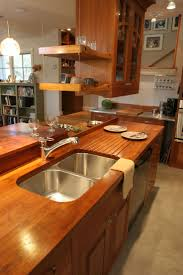 129 best custom wood countertops images on pinterest butcher custom solid wood face grain teak counter top with integrated sloping drain board and under mount sink i don t care about the teak