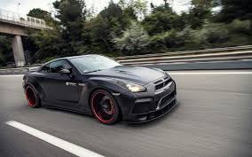 black nissan black nissan gt r pd750 widebody racing down the highway