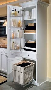 pull out baskets for bathroom cabinets linen closet with chrome shelving rack on door and a removable