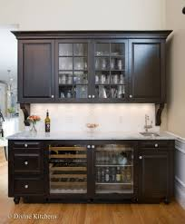 wet bar with dark raised panel cabinetry crown molding corbels
