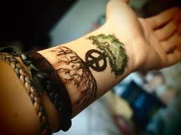 peace symbol and tree tattoo on left wrist for men