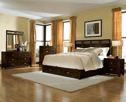 light yellow wall painting long cream curtains dark wood bed room