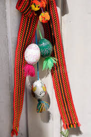 decoration of a bundle of plants eggs striped ribbons for easter