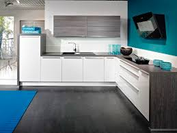white gloss kitchen with grey tiles