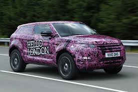 land rover purple land rover wraps evoque prototypes in funky camouflage and hits