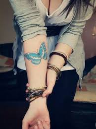 beautiful butterfly on arm photo meaning design idea for
