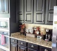 painting your kitchen cabinets black these ideas will totally transform your kitchen cabinets