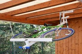 Bicycle Ceiling Hoist by Flat Bike Lift Ingenious Way To Park Your Bicycle On The Ceiling