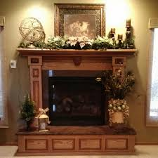 mantle decor with flower vase and the decoration of wreaths and a
