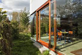 astonishing glass wall with light brown wood frame and disguise