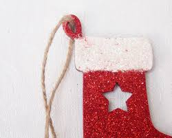 traditional wooden christmas stocking tree decoration with glitter