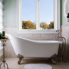 bathroom ideas with clawfoot tub glass windows with small bathroom mat and classic clawfoot tub