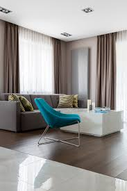 Living Rooms With Grey Sofas colourful modern living room turquoise armchair white coffee