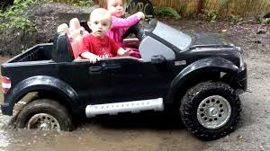 power wheels for girls high volts rc power wheels mudding tommy u0027s first mud bog youtube