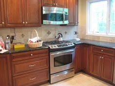 kitchens kraftmaid cabinets ginger sandstone glass tiles suzie