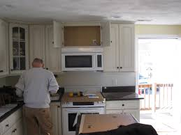 How To Install Wall Kitchen Cabinets How To Install A Vented Microwave Oven