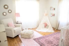 Pink Rug Nursery Why You Want To Try Layering Rugs In Your Nursery