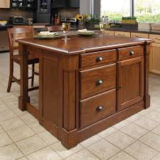 kitchen island with drawers shop home styles brown midcentury kitchen island with 2 stools at
