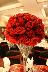classy red rose half topiary ball on tall martini vase by all