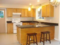 Kitchen Cabinet Designs For Small Kitchens by Birch Cabinets With Black Countertops Like The Clean Style Of