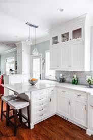 appealing white kitchen cabinets granite dark wood floors blue