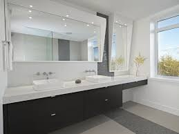 black slate tile floor in bathroom with wood vanity wood floors