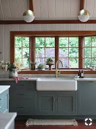 rustic blue gray kitchen cabinets blue gray cabinets white paneling stained wood trim