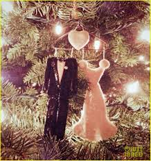 kate bosworth hangs wedding ornament on tree photo