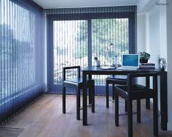 blue vertical window blinds for a dining room with black chairs