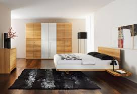 minimalist bedroom furniture with black carpet and wooden